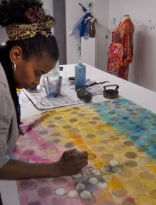 Sunya Folayan in the sanctuary of  her studio,  bringing a textile mediation piece to life.